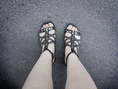 Feet in sandals — Stock Photo