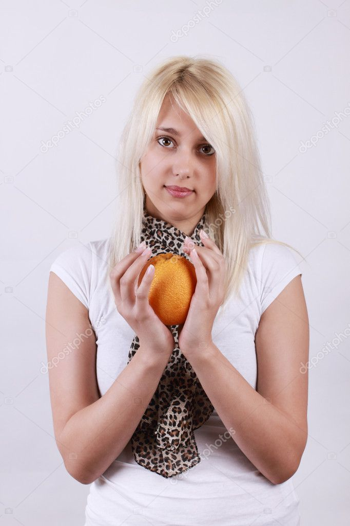 Girl with orange against white background — Stock Photo #10107047