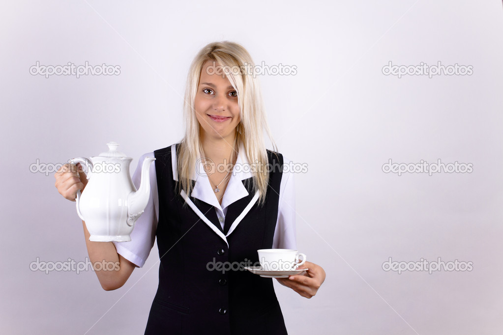 Smiling beautiful blonde girl with a white cup and pot — Stock Photo #10225083