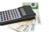 L'argent et les calculatrice — Photo