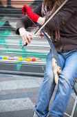 Playing an instrument in the street — Photo
