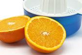 Juicer with oranges — Stock Photo