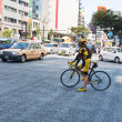 Cycling in the district of Ginza, Japan — Stock Photo