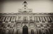 Building Real Casa de Correos in Madrid, Spain. Photograph in sepia — Stock Photo