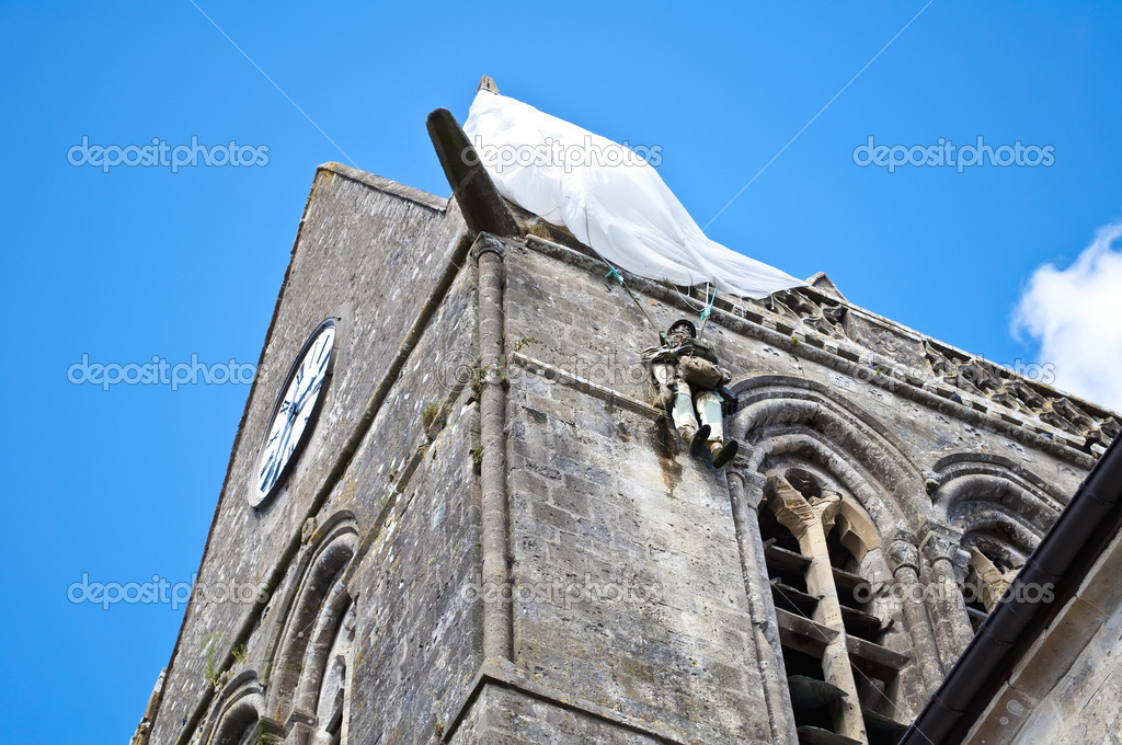 American Doll posted a paratrooper in the Church of Sainte-Mere-Eglise in Normandy, France — Stock Photo #10427454
