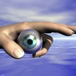 Digital composition of eye and hand — Stock Photo #10093777