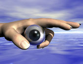 Digital composition of eye and hand — Stock Photo