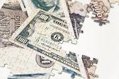 Puzzle de dinero — Foto de Stock