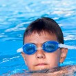 The boy floats in pool — Stock Photo