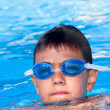 Stock Photo: The boy floats in pool