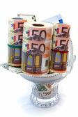 Monetary denominations laid in a vase — Stock Photo