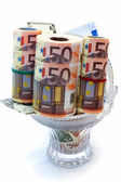 Monetary denominations laid in a vase — Stock Photo