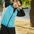 Young man warming-up at early morning — Stock Photo