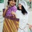 Beautiful young couple after shopping. Outdoor shot — Stock Photo #10323323
