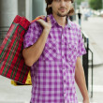 Beautiful young man after shopping. Outdoor shot — Stock Photo
