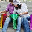 Beautiful young couple after shopping. Outdoor shot — Stock Photo