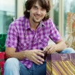 Beautiful young man after shopping. Outdoor shot — Stock Photo