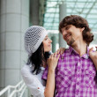 Beautiful young couple after shopping. Outdoor shot — Stock Photo #10323612