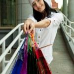 Beautiful brunet woman after shopping. Outdoor shot — Stock Photo