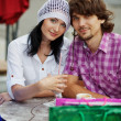 Beautiful young couple after shopping. Outdoor shot — Stock Photo #10323673