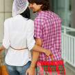 Beautiful young couple after shopping. Outdoor shot — Stock Photo #10323776