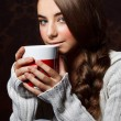 Stock Photo: Beautiful young girl drinking hot chocolate