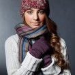 Beautiful girl in winter clothes. Studio shot - Stock Photo