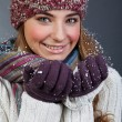 Stock Photo: Beautiful girl in winter clothes. Studio shot