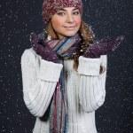 Beautiful girl in winter clothes. Studio shot — Stock Photo
