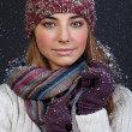 Beautiful girl in winter clothes. Studio shot — Stock Photo #10325602