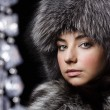 Beautiful young girl in fur clothes. Studio shot — Stock Photo #10325652