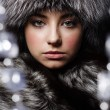 Beautiful young girl in fur clothes. Studio shot — Stock Photo #10325697