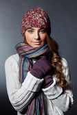 Beautiful girl in winter clothes. Studio shot — Stock Photo