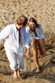 Beautiful couple having rest on river beach — Stock Photo
