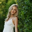 Stock Photo: Beautiful Blond Girl With Trees, White Dress