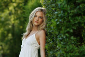 Beautiful Blond Girl With Trees, White Dress — Stock Photo