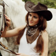 Stock Photo: Beautiful cowgirl. Shot in stable