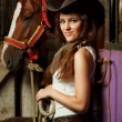 Beautiful cowgirl. Shot in the stable — Stok fotoğraf
