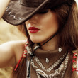 Beautiful cowgirl. Shot in the stable — Stock Photo #10492784