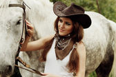 Beautiful cowgirl. Shot in the stable — Stock Photo