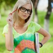 Beautifull college student in park. Outdoor shot — Stock Photo #10695182