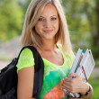 Stock Photo: Beautifull college student in park. Outdoor shot