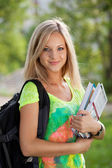 Beautifull college student in park. Outdoor shot — Stock Photo