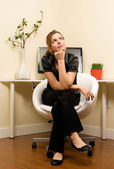 Pondering young Woman in Home Office — Stock Photo