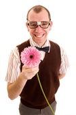 Smiling Geeky Guy with Flower — Stock Photo