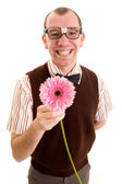 Smiling Nerd offering a flower. — Stock Photo