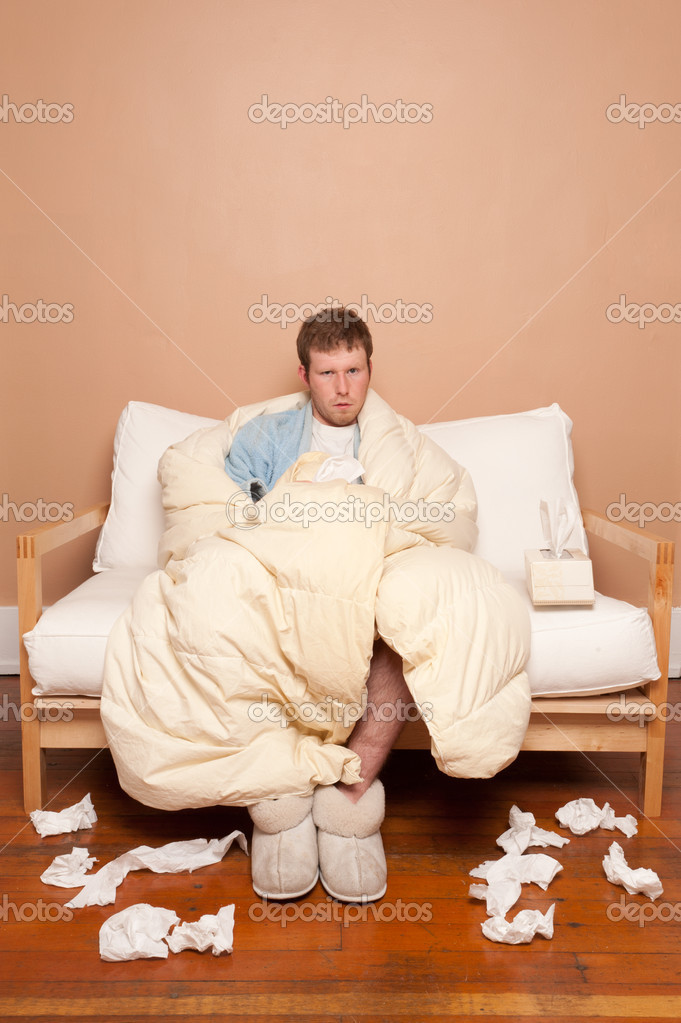 This image shows a sick man on the couch — Stock Photo #10269377
