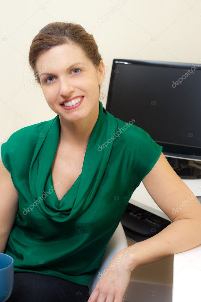 This image shows a woman in her home office — Stock Photo #10269579