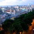 Stock Photo: Night lights of Consulado Street, Havana, Cuba