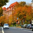 Autumn street with cars in Fulda, Hessen, Germany - Stock Photo